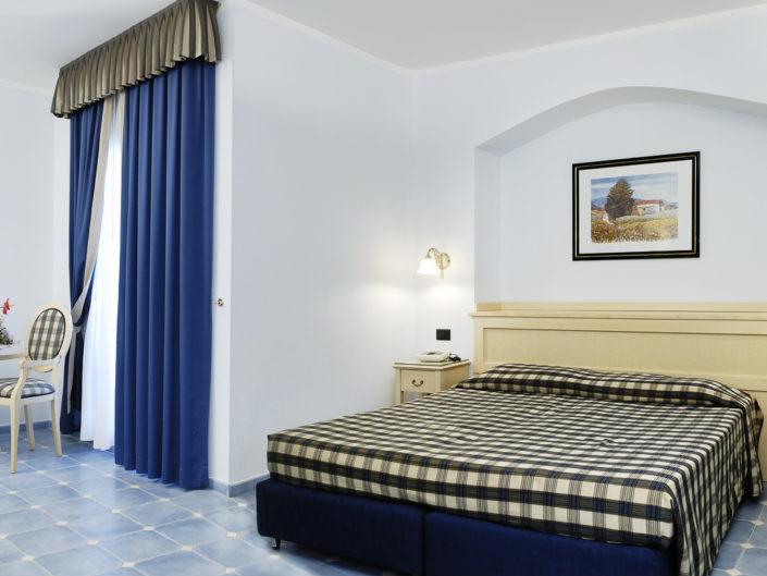 Fotografia per un albergo, camera matrimoniale mini suite, fotografo Nino Lombardo